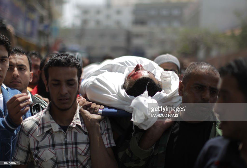 Palestinians mourners carry the body of Haitham Al-Meshal, during his funeral in Gaza City, on April 30, 2013. An Israeli air strike on Gaza City killed one person Palestinian officials said, with Israel saying it targeted a militant involved in a rocket attack on Eilat on April 17.
