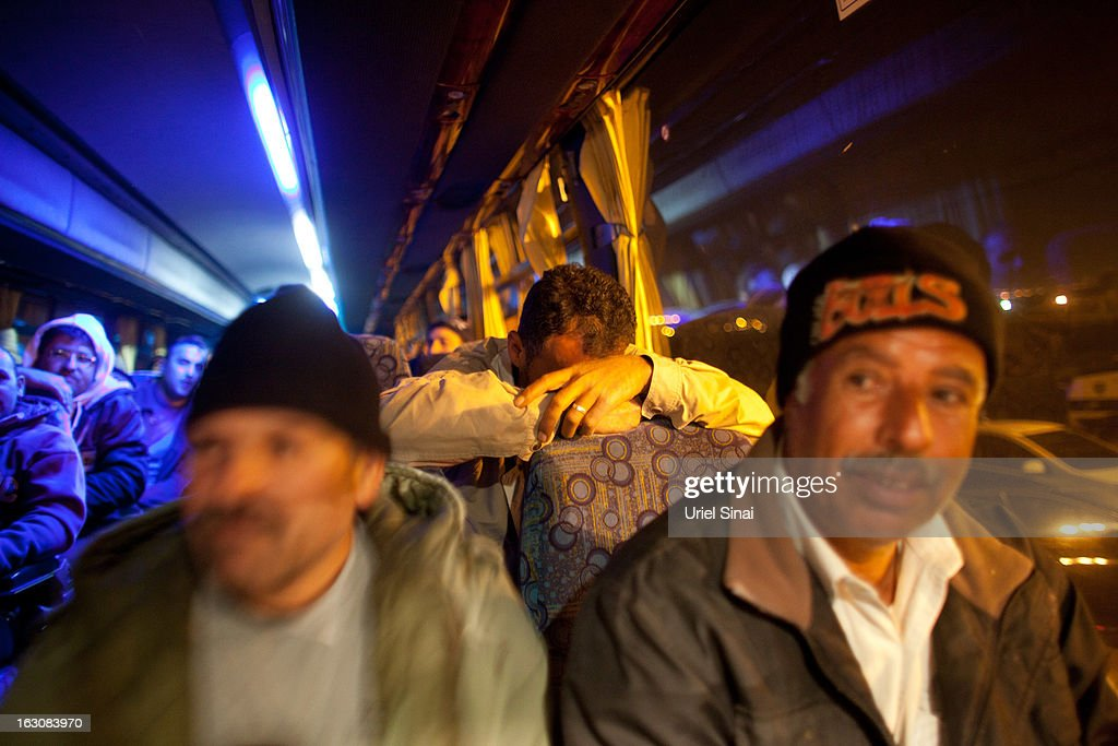 Palestinians on board a bus as a new line is made available by Israel to take Palestinian labourers from the Israeli army crossing of Eyal, near the West Bank town of Qalqilya, into the Israeli cities, on March 4, 2013. at Eyal crossing, West Bank.The new line service to ferry Palestinian workers from the West Bank to Israel, encouraging them to use it instead of traveling with Israeli settlers on a similar route.