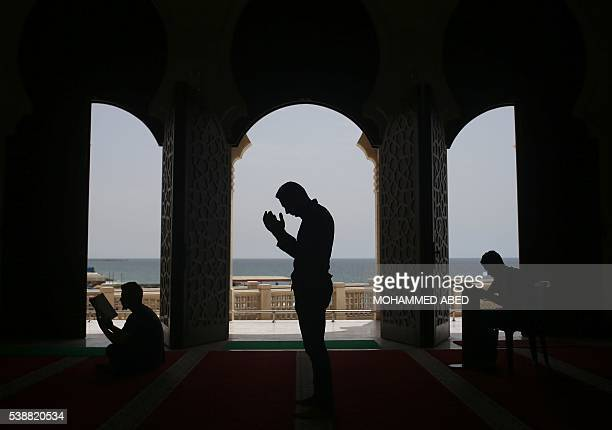 TOPSHOT Palestinians pray at the alKhaldi mosque in Gaza City on June 8 2016 on the third day of the Muslim holy month of Ramadan Islamic authorities...