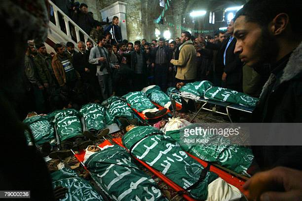 Palestinians pray over the bodies of seventeen victims including the son of foreign minister and Hamas Movement leader Mahmoud AlZahhar Hussam at the...
