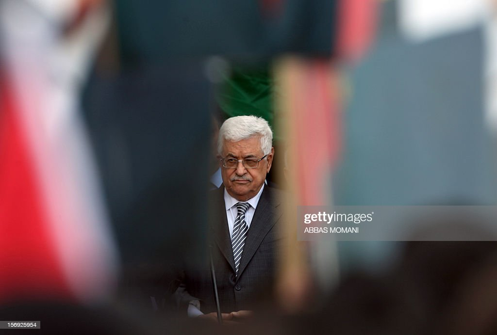 Palestinians President Mahmud Abbas readies to give a speech at his headquarters in the West Bank city of Ramallah, on November 25, 2012, where he said he was 'fully confident' ahead of a fresh attempt to seek upgraded Palestinian status at the United Nations on November 29.
