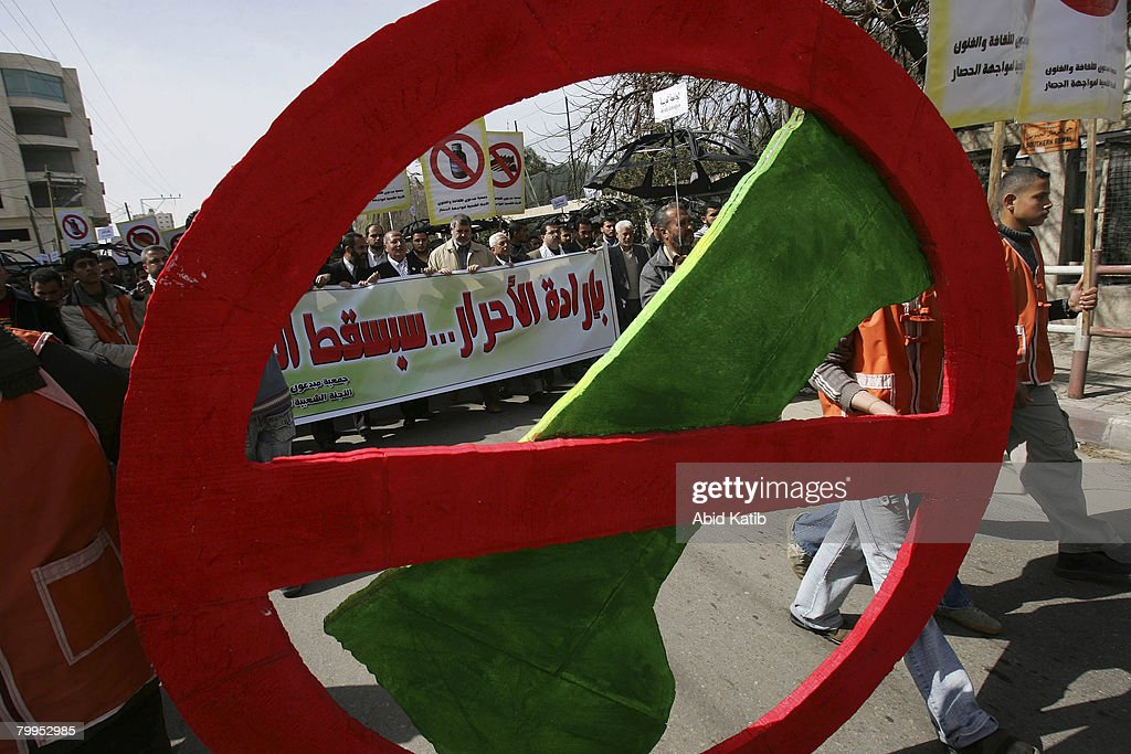 Palestinians protest against the siege of Gaza holding a map of Gaza to symbolise 'Keep Out', February 23, 2008 in Gaza city, Gaza Strip. Hundreds of Palestinians attended the demonstration, against the siege of Gaza, in front of the Gaza UN headquarters.