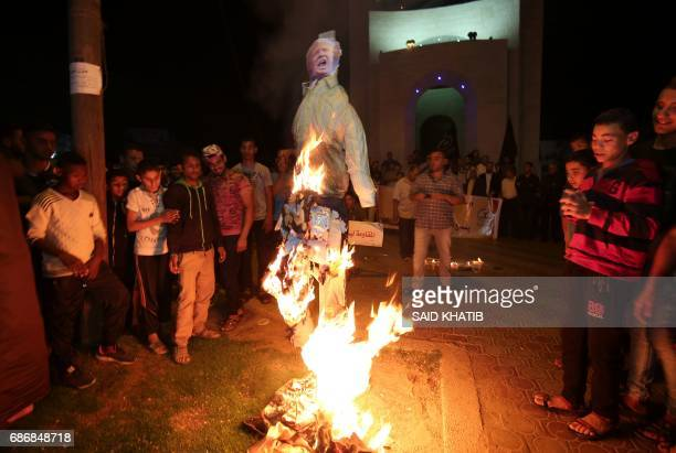 Palestinians protest against the visit by US President Donald Trump to Israel in Rafah in the southern Gaza Strip on May 22 2017 US President Donald...