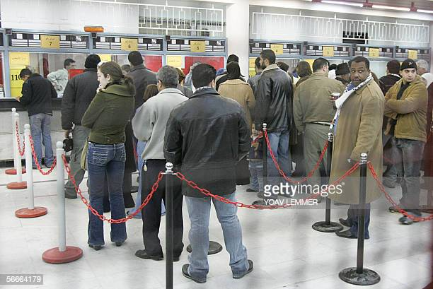 Palestinians queue at the Salahaldin Street post office polling station 25 January 2006 as they wait to cast their vote on election day in Arab east...