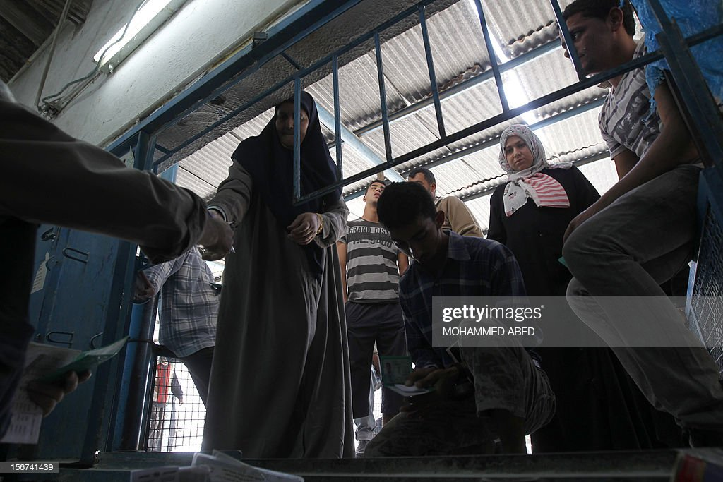 Palestinians queue for aid at a UN supplies center after it was damaged in an Israeli airstrike directed at the nearby Hamas police headquarters at the Jabalya refugee camp, in the northern Gaza Strip on November 20, 2012. Israel halted a threatened Gaza ground offensive to give Egyptian-led truce talks a chance as top diplomats flew in to boost efforts to end nearly a week of cross-border violence.