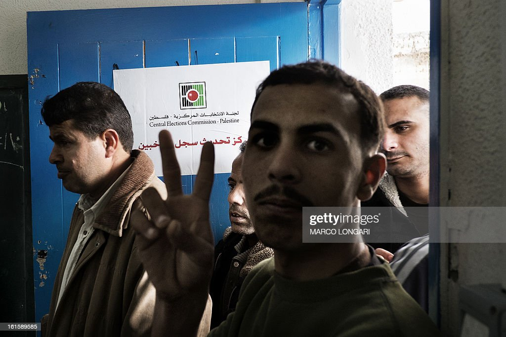 Palestinians queue up at an electoral registration point at a school in Gaza City on February 12, 2013. Palestinian electoral officials began the long-overdue process of updating voter rolls in the West Bank and Gaza in a vital step towards eventual elections. AFP PHOTO/MARCO LONGARI