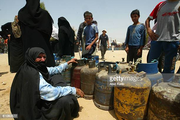 Palestinians queue up to fill gas canisters outside a filling station on May 12 2008 in Rafah Gaza Strip Israeli sanctions have resulted in limited...