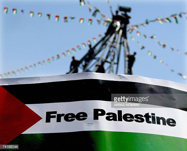 Palestinians rally in the center of West Bank city of Ramallah decorated with the Palestinian flags to mark the 59th anniversary of the alNakba or...