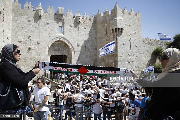 Palestinians react as a group of Jewish settlers forced their way into AlAqsa Mosque compound in occupied East Jerusalem as they mark 'Jerusalem Day'...