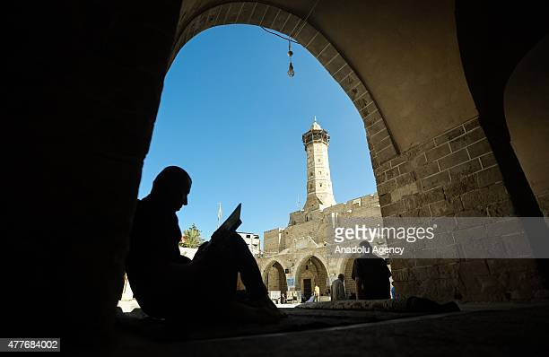 Palestinians read Quran as they wait to break their fast during Ramadan at AlOmari Mosque in Gaza City Gaza on June 18 2015