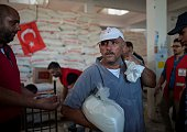 Palestinians receives Turkish humanitarian aid in Gaza City Gaza on July 19 2016 On July 3 The Turkish aid ship 'Lady Leyla' docked in Israels port...