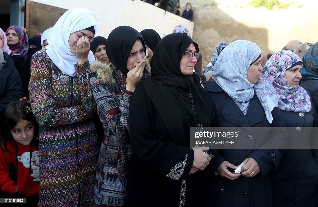 Palestinians relatives mourn during the funeral of teenagers Nihad Waked and Fuad Waked after they were shot dead by Israeli security forces as they reported fired on Israeli soldiers on February 14, 2016 in the village of Araka, West of Jenin in the Israeli occupied West Bank. An Israeli army statement said the two teenagers attacked an Israeli patrol west of the city of Jenin with rocks before firing on soldiers with a rifle. 'The force responded to the shooting and fired towards the attackers, resulting in their deaths,' it said. The Palestinian health ministry named those killed as Nihad Waked and Fuad Waked, both 15 years old. They were not thought to be closely related. ASHTIYEH