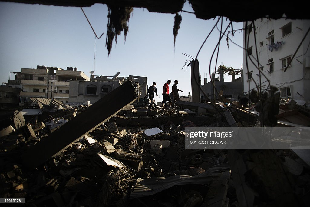 Palestinians salvage for belongings from their destroyed houses following overnight Israeli air strikes on the village of Beit Lahia in the northern Gaza Strip on November 18, 2012. Israeli war planes hit a Gaza City media centre and homes in northern Gaza in the early morning, as the death toll mounted, despite suggestions from Egypt's President Mohamed Morsi that there could be a 'ceasefire soon.' AFP PHOTO/MARCO LONGARI