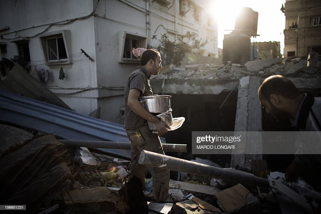Palestinians salvage items from their damaged house following Israeli air strikes on the village of Beit Lahia in the northern Gaza Strip on November 18, 2012. Israeli war planes hit a Gaza City media centre and homes in northern Gaza in the early morning, as the death toll mounted, despite suggestions from Egypt's President Mohamed Morsi that there could be a 'ceasefire soon.'