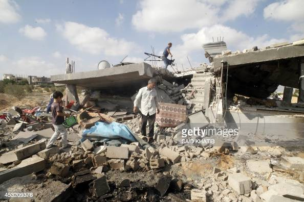 Palestinians salvage their belongings from their destroyed home in Rafah in the southern Gaza Strip on August 5 after a 72hour truce agreed by Israel...