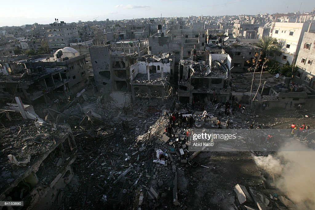 Palestinians search for bodies in the rubble of the destroyed house of Hamas senior leader Nizar Rayan after an Israeli missiles strike in the refugee camp of Jabaliyaon January 1, 2009 in Gaza, Gaza Strip. Israeli warplanes attacked government buildings in the Gaza Strip on New Year's Day after Israel and its Islamist Hamas foe both spurned ceasefire calls in a conflict that has killed around 400 Palestinians and injured around 1,600.