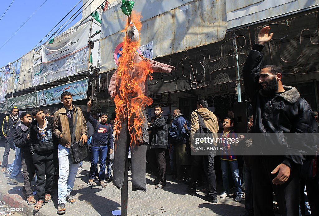 Palestinians set fire to an effigy of US President Barack Obama during a protest against Obama's visit to the West Bank, in the southern Gaza Strip town of Rafah on March 21, 2013. Obama arrived in the West Bank to a more prickly welcome from Palestinian leaders than the warm embrace he won in Israel the day before.