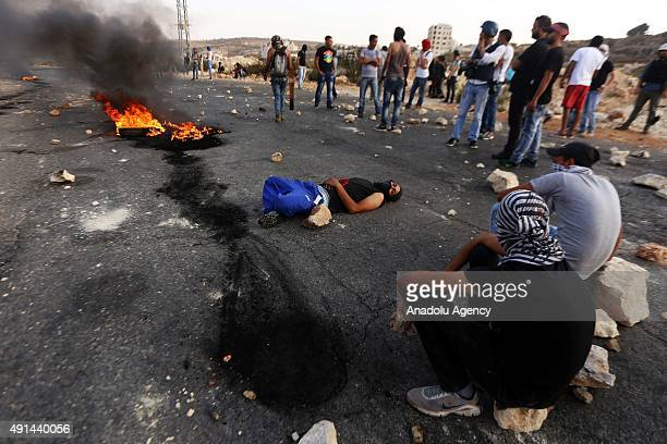 Palestinians set tires on fire during the clashes with Israeli soldiers following a protest against Israeli aggression on Palestinians and alAqsa...