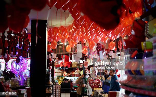 Palestinians shop at a souvenir market on Valentine's Day in Gaza City on February 14 2016