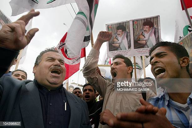 Palestinians shout antiUSA slogans 21 April 2003 during a protest against the arrest of Mohammad Abbas the Palestinian radical known as Abu Abbas who...