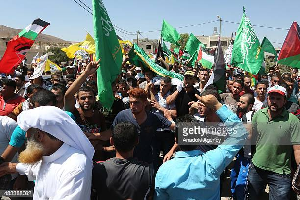 Palestinians shout slogans on August 8 2015 in Duma village of West Bank's city of Nablus during the funeral ceremony of Saad Dawabsheh the father of...
