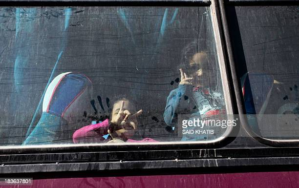Palestinians sit in a coach as they wait to cross into Egypt at the Rafah crossing terminal in the southern Gaza Strip on the border with Egypt on...