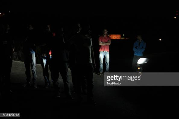 A Palestinians stands on the side road after not allowing them passing the checkpoint by Israeli army and announcing Nablus area a closed military...