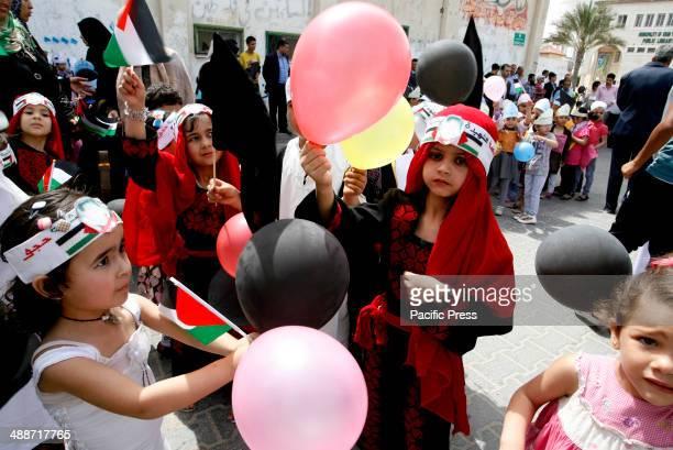 Palestinians take part at a protest organized to mark the 66th anniversary of Nakba and to condemn the international silence towards the rights of...