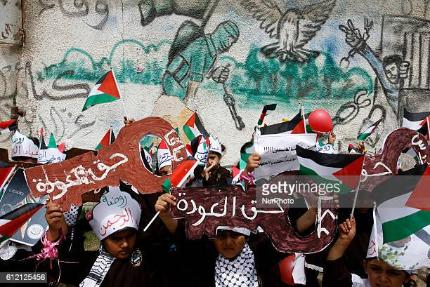 A Palestinians take part at a protest organized to mark the 66th anniversary of Nakba and to condemn the international silence towards the rights of...