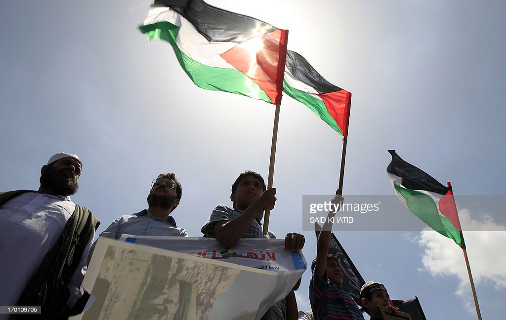Palestinians take part in a demonstration in Gaza city on June 7, 2013, calling for an end to Israeli occupation of Palestine. The Israeli navy has arrested two Palestinian fishermen off the coast of the Hamas-ruled Gaza Strip, sources on both sides said.