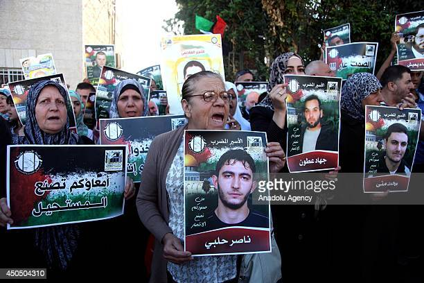 Palestinians take part in a demonstration in support of 125 Palestinian prisoners detained in Israeli jails and who have been on hunger strike for 51...