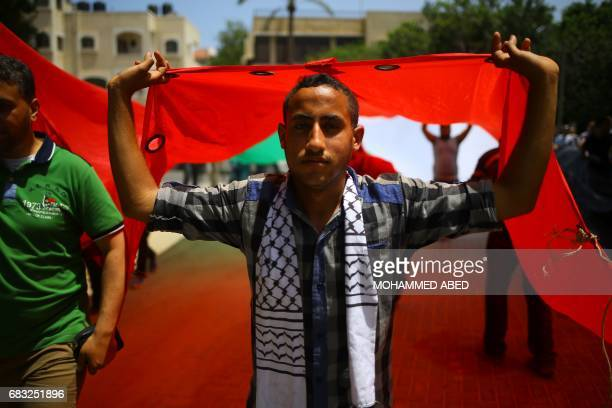 Palestinians take part in a rally to commemorate the 69th anniversary of the 'Nakba' in Gaza City on May 15 2017 'Nakba' means in Arabic...