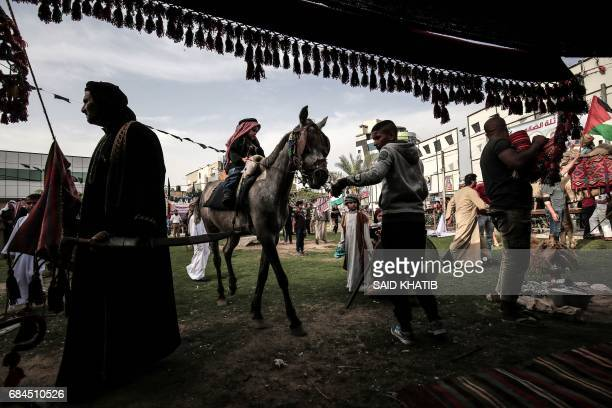 TOPSHOT Palestinians take part in a rally to commemorate the 69th anniversary of the ''Nakba'' in Rafah in the southern Gaza Strip on May 18 2017...