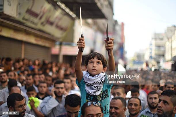 Palestinians take part in an antiIsrael protest in Jabalia in the northern Gaza Strip The unrest that has engulfed Jerusalem and the occupied West...