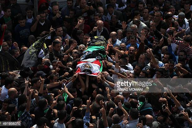 Palestinians take part in the funeral of 19yearold Mohannad Halabi in the West Bank village of Surda near Ramallah on October 9 2015 Halabi killed...
