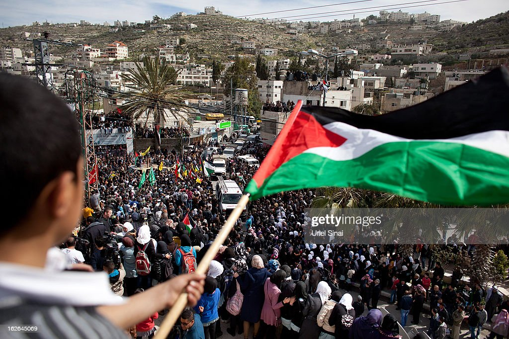 Palestinians take part in the funeral of Arafat Jaradat on February 25, 2013 in the village of Saair in the West Bank. According to reports, Jaradat died while in Israeli custody under disputed circumstances, with Palestinian officials saying an autopsy showed he was tortured.