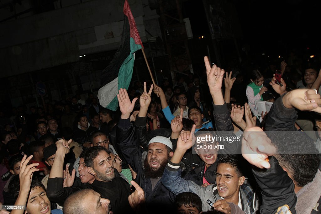 Palestinians take to the streets to celebrate the beginning of the truce with Israel in Rafah town in the southern Gaza Strip on November 21, 2012. Palestinians in Gaza took to the streets to celebrate the start of a truce deal with Israel that was announced in Egypt on the eighth day of violence in and around Gaza.