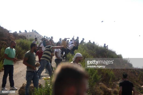 Palestinians throw stones as Israeli forces siege around the hometown of a Palestinian man Monir alAbed who allegedly killed three Jewish settlers in...