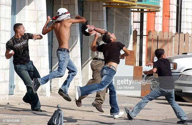 Palestinians throw stones at Isareli soldiers in Al Ram during an Israeli Palestinians protesting Rally against the separated wall in Al Ram east...