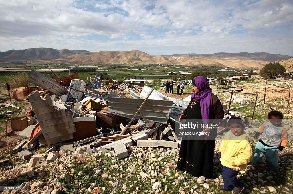 Palestinians try to collect their useable household goods and belongings inside the debris of their house after Israeli authorities demolished some houses, in Al -Jiftlik Village of West Bank's Jericho on February 10, 2016.