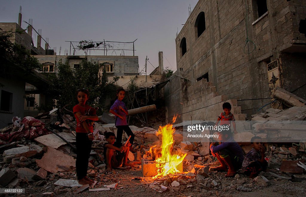 Palestinians try to hold on life amid the debris of buildings destroyed in Israeli attacks on August 16, 2014 in the northeast city Beit Hanoun, Gaza. Apart from killing hundreds of Palestinians and injuring thousands of others, a recent Israeli offensive on the Palestinian territory had left thousands of homes and buildings in Gaza in total ruin.
