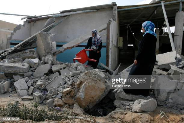 Palestinians try to salvage their belongings from the rubble and debris of destroyed buildings in Rafah in the Southern Gaza Strip during the 72hours...