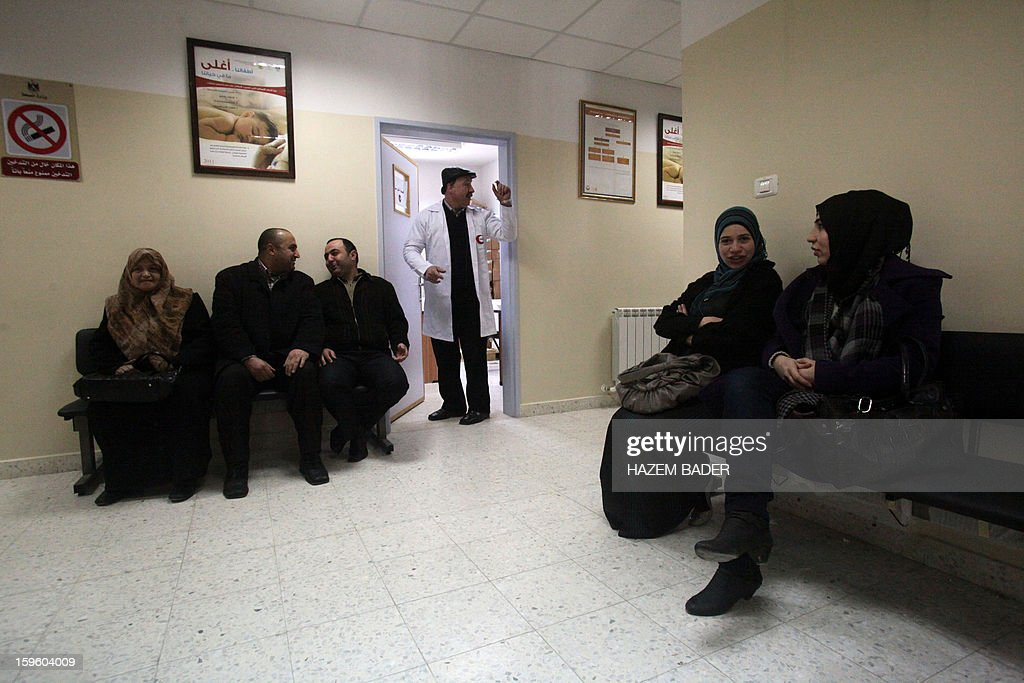 Palestinians visit a clinic to get an injection against flu in the the West Bank town of Hebron on January 17, 2013. Nine Palestinians have died in an outbreak of the H1N1 influenza strain known as swine flu, the office of Palestinian prime minister Salam Fayyad said.
