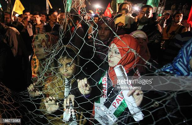 Palestinians wait for released prisoners at Beit Hanoun Border Gate between north of Gaza Strip and Israel on October 30 2013 Israel freed 26...