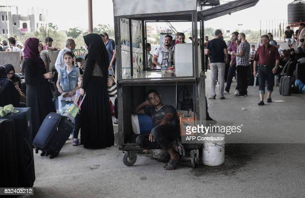 TOPSHOT Palestinians wait for travel permits to cross into Egypt through the Rafah border crossing after it was partially opened by Egyptian...