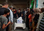 Palestinians wait in line to get Turkish humanitarian aid in Gaza City Gaza on July 19 2016 On July 3 The Turkish aid ship 'Lady Leyla' docked in...