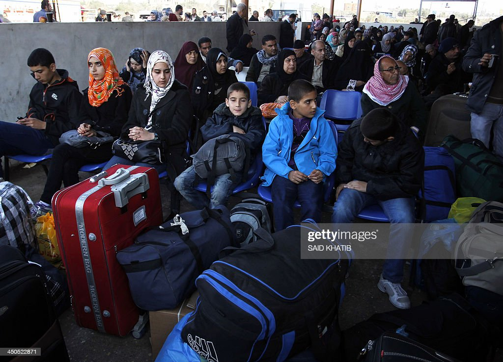 Palestinians wait to cross from the Gaza Strip to Egypt at the Rafah crossing terminal on November 19, 2013. Hundreds of patients, students and foreign residents from the Palestinian side have rushed to the Rafah crossing after the Egyptian announcement of re-opening it for 3 days.