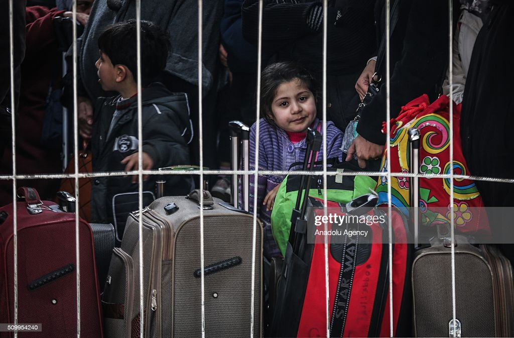 Palestinians wait to cross into Egypt at Rafah border crossing on the border between Egypt and the Gaza Strip in Rafah, Gaza on February 13, 2016.