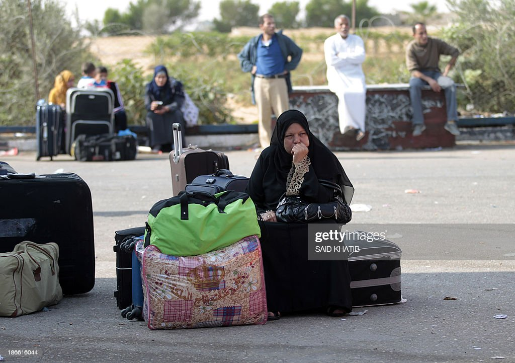 Palestinians wait to cross into Egypt at the Rafah crossing terminal in the southern Gaza Strip on the border with Egypt on November 02, 2013. Hundreds of patients, students and foreign residents from the Palestinian side have rushed to the Rafah crossing after the Egyptian announcement of re-opening it for 6 days.