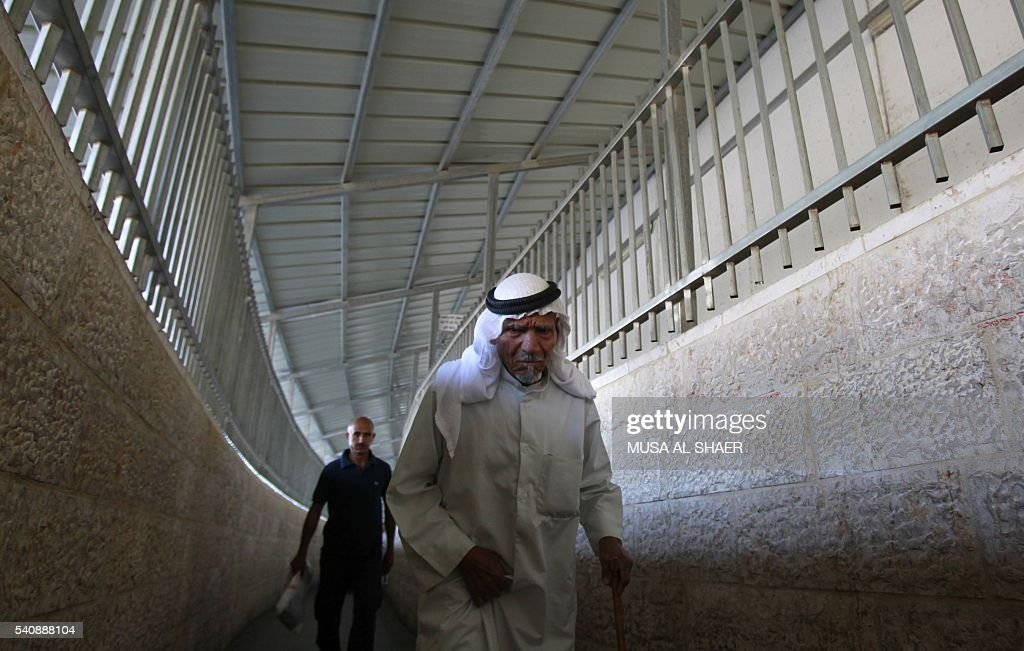 Palestinians walk through an Israeli checkpoint between the West Bank town of Bethlehem and Jerusalem as Muslim worshippers head to Friday noon...